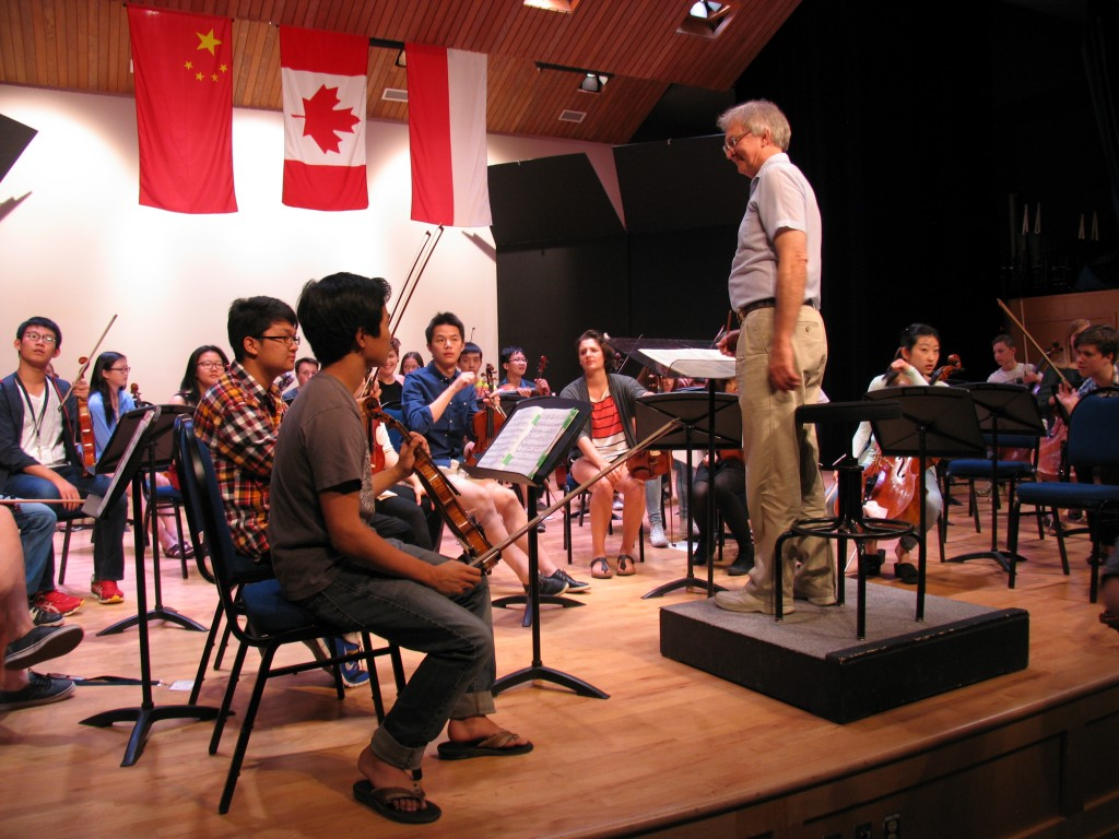 Mount Royal Conservatory  conductor John Thompson takes the Morningside Music Bridge orchestra through a final rehearsal.