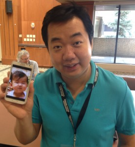 Acclaimed violinist and proud papa Ning Feng shows off his new baby.