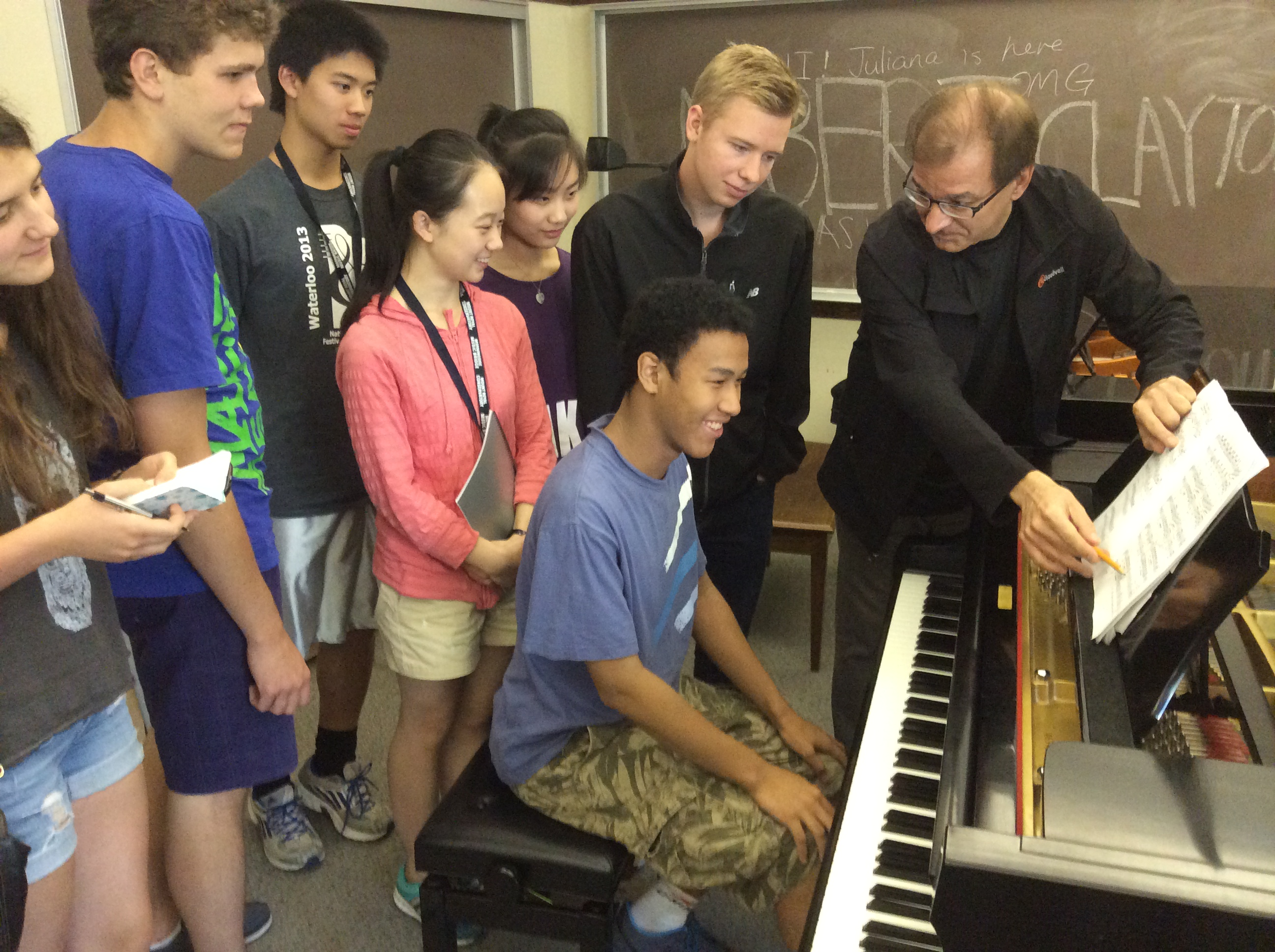 Morningside Music Bridge piano students take in a master class with faculty member David Moroz.