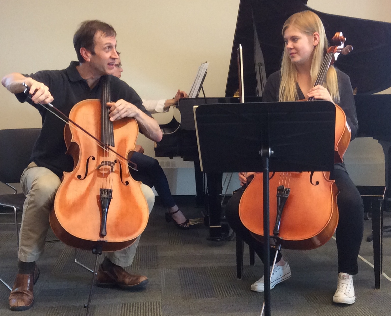 New Orford String Quartet cellist Brian Manker instructs Zophia, a 17-year-old student from Poland, during a master class at Morningside Music Bridge in Calgary.